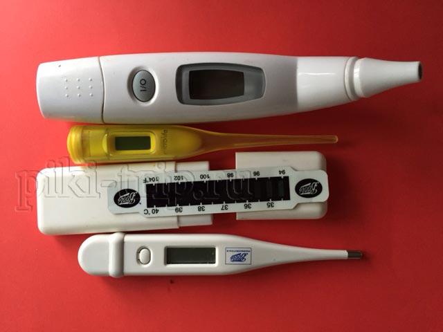 в госпиталях Паттайи меряют температуру детям электронным градусником, тем что снизу на фото